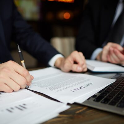 Businessman Reading Contract Closeup